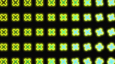 düzen : Animation of seamless loop of multiple rows of glowing yellow and green crossed rotating in formation, green circle with red rays appearing and disappearing on black background. Repetition and order concept.
