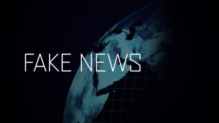 falsificação : Animation of the words Fake News written in white and rotating blue glowing digital globe with white grid flickering with interruption of data processing moving on black background. Global technology media and information network concept.