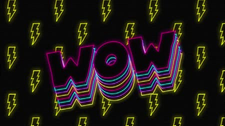 espaço de texto : Animation of vintage video game screen with the word Wow overlapping in magenta, cyan, yellow outlined capital letters bouncing with yellow flash shapes moving and a green circle appearing and disappearing on black background. Vintage video game concept. Stock Footage