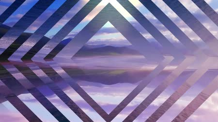 em camadas : Animation of layers of mirror glass diamond shapes moving in seamless loop in repetition over countryside with coastline, sea and mountains at sunset in the background. Geometric scenery nature kaleidoscopic motion concept digital composite.