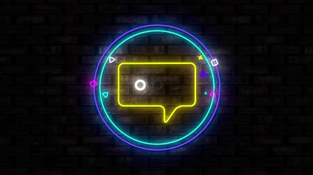 неон : Animation of illuminated blue circle neon sign with moving chat message icon flickering on black brick wall in the background. Social media and internet communication concept digitally generated image.