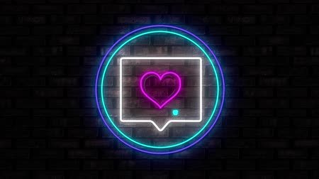 hoşlanmak : Animation of illuminated blue circle neon sign with moving message with love heart icon flickering on black brick wall in the background. Social media and internet communication concept digitally generated image. Stok Video