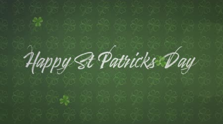 patron : Animation of the words Happy St. Patricks Day written in white letters, with multiple green shamrock clover leaves dropping on green shamrock patterned background. Celebration of Irish culture concept digitally generated image. Stock Footage