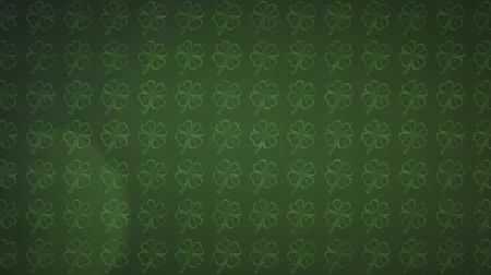 patron : Animation of St Patricks Day pattern of multiple rows of outlines of green shamrocks with spots of light moving and flickering on dark green background. Celebration of Irish culture concept digitally generated image. Stock Footage