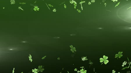 st patrick : Animation of St Patricks Day multiple shimmering floating green shamrocks on top and bottom with spots of light on glowing green background. Celebration of Irish culture concept digitally generated image.