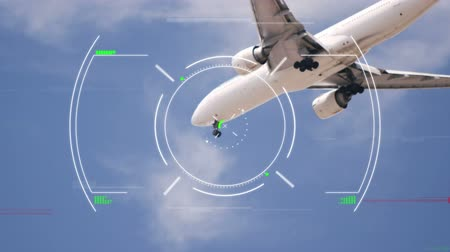 samolot : Animation of global network of connections and data processing globe spinning air traffic control system, with aeroplane flying against blue sky in the background. Global connections travel concept digital composite.