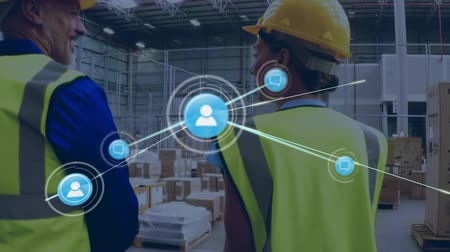 busy line : Animation of network of connections with people icons, digital data processing with busy Caucasian male warehouse workers in helmets and yellow vests in the background. Digital network of global connections networking business concept digital composite. Stock Footage