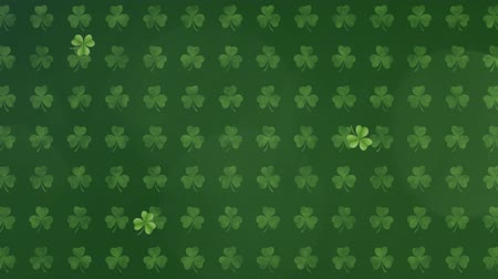 patron : Animation of St Patricks Day pattern of multiple rows of green shamrocks with spots of light moving and flickering on dark green background. Celebration of Irish culture concept digitally generated image.