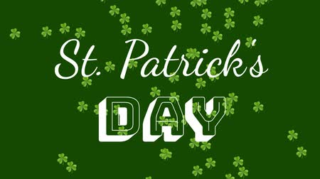 patron : Animation of the words St. Patricks Day written in white letters, with multiple green shamrock clover leaves falling on dark green background. Celebration of Irish culture concept digitally generated image. Stock Footage