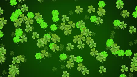 patron : Animation of St Patricks Day multiple floating light and dark green shamrocks on dark green background. Celebration of Irish culture concept digitally generated image.