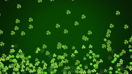 patron : Animation of St Patricks Day multiple shimmering floating light and dark green shamrocks with spots of light on dark green background. Celebration of Irish culture concept digitally generated image.