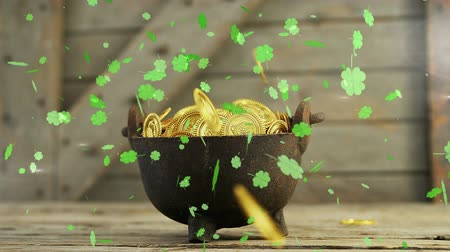 patron : Animation of St Patricks Day multiple shimmering floating light green shamrocks with golden coins falling into a pot on a wooden rustic background. Celebration of Irish culture concept digitally generated image. Stock Footage