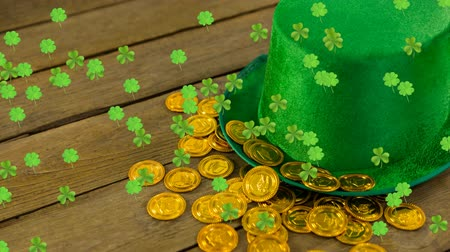 patron : Animation of St Patricks Day multiple shimmering floating green shamrocks with green hat and golden coins on wooden boards in the background. Celebration of Irish culture concept digitally generated image.