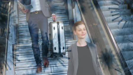klatka schodowa : Animation of multiple macro corona virus spreading and floating with man and woman walking down the staircase at an airport carrying a suitcase in the background. Global health warning scare spreading infections concept digital composite.