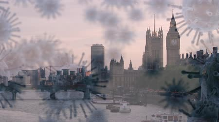 koróna : Animation of multiple macro corona virus spreading and floating with London cityscape in the background. Global health warning scare spreading infections concept digital composite.
