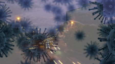 organizma : Animation of multiple macro corona virus spreading and floating with aerial view of cityscape with road traffic in fast motion in the evening in the background. Global health warning scare spreading infections concept digital composite. Stok Video