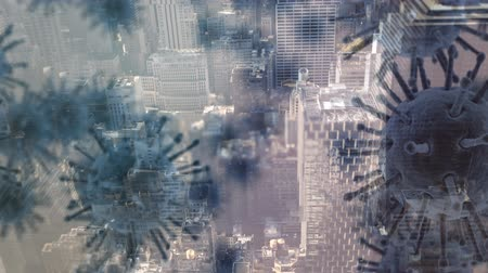 alerta : Animation of multiple macro corona virus spreading and floating with aerial view of cityscape in the background. Global health warning scare spreading infections concept digital composite.
