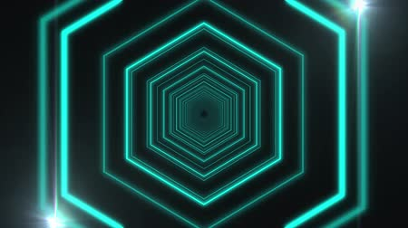 distorsiyon : Animation of tunnel of multiple glowing distorted turquoise hexagon outlines moving in repetition with glowing spot lights on black background. Repetition and flowing light motion digitally generated image. Stok Video