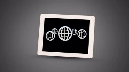 データベース : Animation of five globes with white outlines displayed on screen of digital tablet on grey gradient background. Global communication modern technology concept digitally generated image.