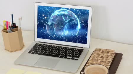 world cup : Animation of globe spinning displayed on screen of laptop computer on desk with cup of coffee and office items. Global communication modern technology concept digitally generated image. Stock Footage