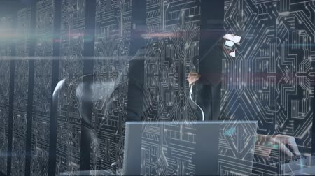 provider : Animation of man in a mask hacking computers, data processing and digital information flowing through network of computer servers in a server room with white light trails flowing on surface. Global network of internet service provider or data processing c Stock Footage