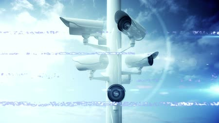 контур : Animation of Closed Circuit Television cameras moving around with horizontal flickering lines in fast motion with sky background. Global network of surveillance technology concept digital composite.