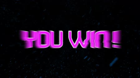you win : Animation of flickering words You Win! written in pink letters with multiple blue sparkling particles of colour on black background. Digital computer interface and networking communication concept digitally generated image. Stock Footage