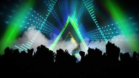 triângulo : Animation of pulsating triangles moving in seamless loop in hypnotic motion and silhouettes of people with arms in the air at a music concert. Video computer game screen and digital interface concept digitally generated image. Stock Footage