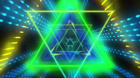 triângulo : Animation of yellow, blue and green glowing pulsating triangles moving in seamless loop in hypnotic motion on black background. Abstract colour and pattern motion in repetition concept digitally generated image.