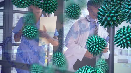 organizma : Animation of macro green coronavirus cells flowing and spreading with male and female doctors running in hospital on white background. Global medicine public health pandemic coronavirus outbreak concept digitally generated concept.