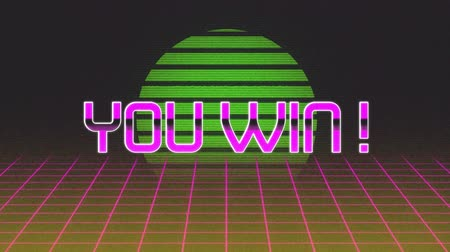 you win : Animation of the words You Win! written in pink metallic letters over pink grid moving in seamless loop in hypnotic motion and green glowing circle in the background. Video computer game screen and digital interface concept digitally generated image.