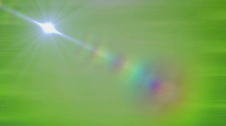 hale : Animation of a glowing star moving on a straight line with rainbow halo on green gradient background. Abstract light and movement concept digitally generated image.