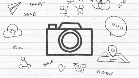 mani disegnate : Animation of black outlined camera icon hand drawn with a marker with multiple hand drawn icons on white lined paper. Global digital communication and social networking concept digital composite.