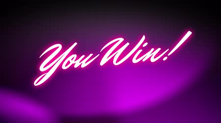 Animation of the words You Win! written in pink glowing neon letters over moving pink spotlights on black background. Video computer game screen and digital interface concept digitally generated image. Stock Footage