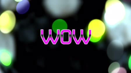 shimmer : Animation of the word Wow written in pink mettallic letters written over floating multi coloured particles spots of light on black background. Video computer game screen and digital interface concept digitally generated image.