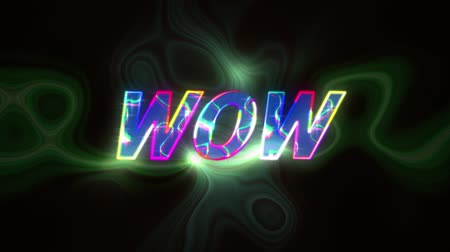 Animation of the word Wow written in multi colored changing letters over glowing and shimmering green clouds of smoke in the background. Video computer game screen and digital interface concept digitally generated image. Stock Footage