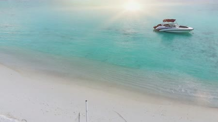 kumlu : Beautiful tropical Maldives island with white sandy beach and sea in  sunshine  day for holiday vacation . Stok Video