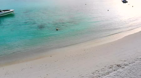 maldív szigetek : Beautiful tropical Maldives island with white sandy beach and sea in  sunshine  day for holiday ,summer, vacation .