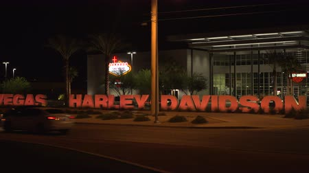 motorkerékpár : 4K ES: The new Las Vegas Harley-Davidson motorcycle shop at the south end of the Las Vegas Strip brought not not only jobs to the Las Vegas Valley but large numbers of tourists. Circa - 2016 Sony FS-5 UHD w Zeiss 28mm prime lens.