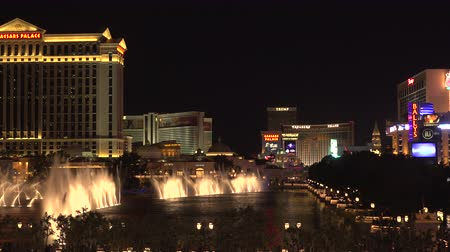 flaming : 4K ES: The Las Vegas Strip skyline highlighted by the world famous water fountain show at the Bellagio Resort & Casino. Circa 2016 Filmed on Sony FS-5 w 28mm Zeiss prime lens at 4K UHD 30P Native Resolutions.