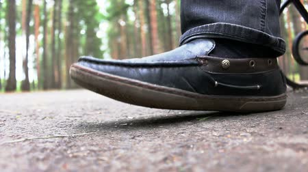 haughty : Black patent leather mens shoes stomping or fills rhythm on open air