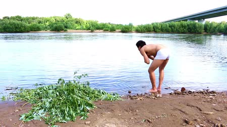 lesser poland : Man washes his face in mountain creek or river