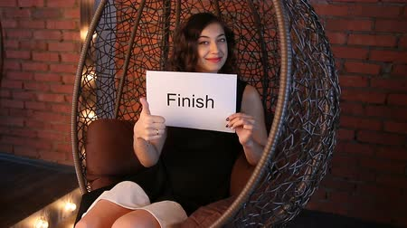 supermodel : Young girl holding a sign: Finish