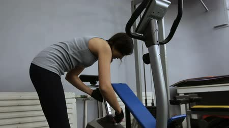 revitalizing : A young girl is getting ready for a workout on a exercise bike