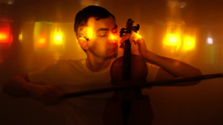 serenade : Young man plays the violin in nightclub