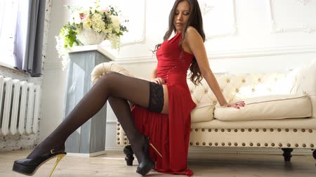 rajstopy : Sexy woman in red dress stroking leg Wideo