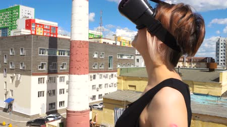 invisible : woman uses a virtual reality glasses on the roof