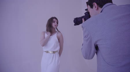 feminity : Photographer and beauty female model in photo studio. Stock Footage