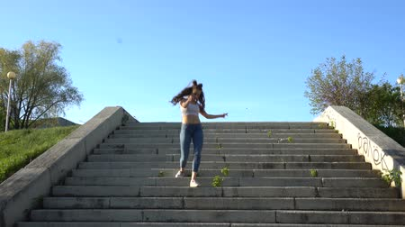 aşağıda : Stylish girl dancing on stairs