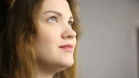 close cropped : close-up of a womans caucasian face indoor